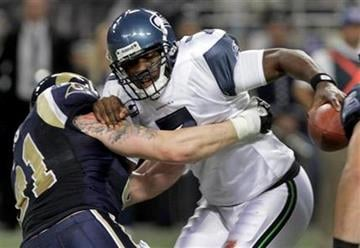 Seattle Seahawks quarterback Tarvaris Jackson, right, is sacked for a 12-yard loss by St. Louis Rams defensive end Chris Long during the second quarter of an NFL football game, Sunday, Nov. 20, 2011, in St. Louis. (AP Photo/Seth Perlman) By Seth Perlman