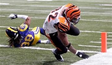 Cincinnati Bengals running back Cedric Benson, right, scores past St. Louis Rams defensive back Josh Gordy on a 4-yard touchdown run during the fourth quarter of an NFL football game Sunday, Dec. 18, 2011, in St. Louis. (AP Photo/Tom Gannam) By Tom Gannam