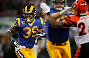 St. Louis Rams running back Steven Jackson (39) runs with the ball against the Cincinnati Bengals' defense during the first quarter of an NFL football game on Sunday, Dec. 18, 2011, in St. Louis. (AP Photo/Jeff Roberson) By Jeff Roberson