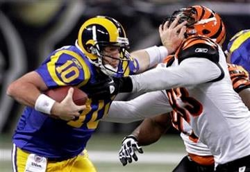 St. Louis Rams quarterback Kellen Clemens, left, runs past Cincinnati Bengals defensive end Michael Johnson during the third quarter of an NFL football game Sunday, Dec. 18, 2011, in St. Louis. (AP Photo/Seth Perlman) By Seth Perlman