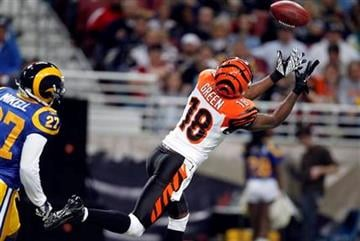 Cincinnati Bengals wide receiver A.J. Green, right, catches a 55-yard pass as St. Louis Rams safety Quintin Mikell looks on during the first quarter of an NFL football game Sunday, Dec. 18, 2011, in St. Louis. (AP Photo/Jeff Roberson) By Jeff Roberson