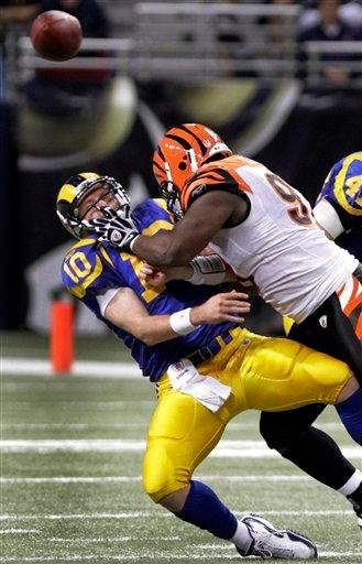 St. Louis Rams quarterback Kellen Clemens, left, is hit as he throws by Cincinnati Bengals defensive tackle Geno Atkins during the third quarter of an NFL football game Sunday, Dec. 18, 2011, in St. Louis. (AP Photo/Seth Perlman) By Seth Perlman