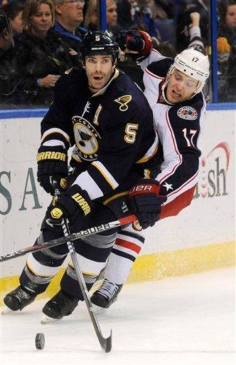 St. Louis Blues' Barret Jackman (5) gets around Columbus Blue Jackets' Mark Letestu (17) during an NHL hockey game Sunday, Dec. 18, 2011, in St. Louis. (AP Photo/Bill Boyce) By Bill Boyce