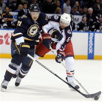 St. Louis Blues' Patrik Berglund (21), of Sweden, and Columbus Blue Jackets' Rick Nash (61) reach for the puck during the first period of an NHL hockey game Sunday, Dec. 18, 2011, in St. Louis. (AP Photo/Bill Boyce) By Bill Boyce