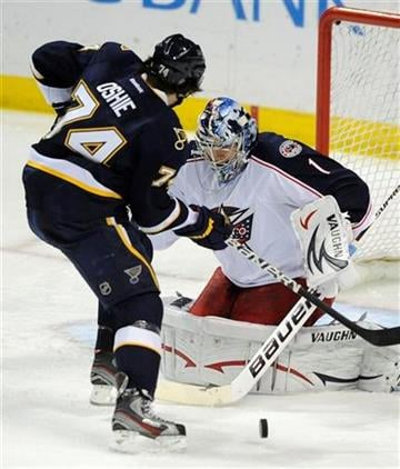 Columbus Blue Jackets' goalie Steve Mason (1) blocks a shot by St. Louis Blues' T. J. Oshie (74) in the second period of an NHL hockey game on Sunday, Dec. 18, 2011, in St. Louis. The Blues won 6-4. (AP Photo/Bill Boyce) By Bill Boyce