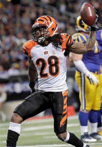 Cincinnati Bengals running back Bernard Scott celebrates after scoring on a 1-yard touchdown run during the third quarter of an NFL football game against the St. Louis Rams on Sunday, Dec. 18, 2011, in St. Louis. (AP Photo/Seth Perlman) By Seth Perlman