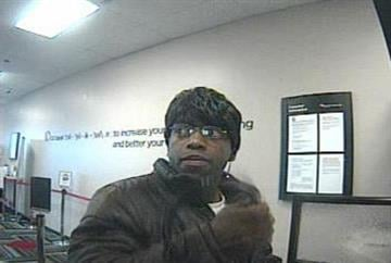 This surveillance photo shows a man accused or robbing the St. Louis Community Credit Union on West Florissant in Dellwood on December 19, 2011. Anyone with information should call CrimeStoppers. By KMOV Web Producer