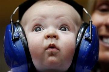 Three-month old Henry Hirschey wears headphones while attending an NCAA college basketball game between Duke and South Carolina Upstate with his mom Rachel in Durham, N.C., Sunday, Dec. 11, 2011. (AP Photo/Gerry Broome) By Gerry Broome