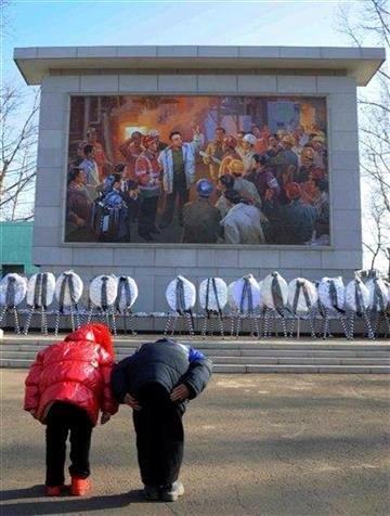 Children bow in front of a large mosaic of the late North Korean leader Kim Jong Il outside the Chollima Steel Mill Complex on the western outskirts of Pyongyang on Thursday Dec. 22, 2011. (AP Photo) By KMOV Web Producer