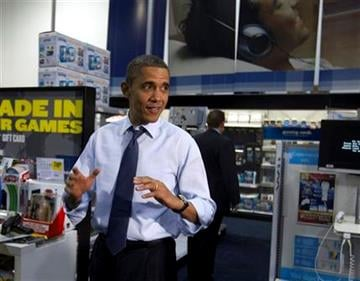 President Barack Obama shops for Christmas gifts for his family at Best Buy, Wednesday, Dec. 21, 2011, in Alexandria, Va. (AP Photo/Carolyn Kaster) By Carolyn Kaster