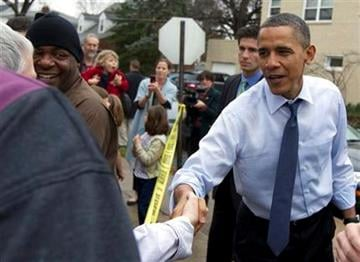 President Barack Obama greets people outside of Del Ray Pizzeria, Wednesday, Dec. 21, 2011, in Alexandria, Va. (AP Photo/Carolyn Kaster) By Carolyn Kaster