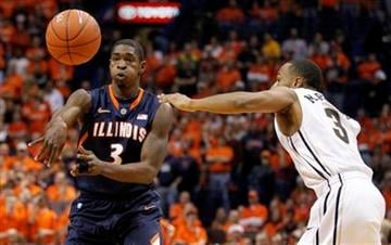 Illinois' Brandon Paul, left, passes the ball as Missouri's Matt Pressey defends during the first half of an NCAA college basketball game Thursday, Dec. 22, 2011, in St. Louis. (AP Photo/Jeff Roberson) By Jeff Roberson