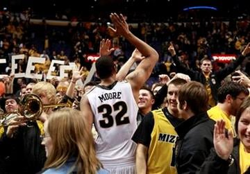 Missouri's Steve Moore celebrates with fans after Missouri's 78-74 victory over Illinois in an NCAA college basketball game Thursday, Dec. 22, 2011, in St. Louis. (AP Photo/Jeff Roberson) By Jeff Roberson