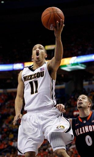 Missouri's Michael Dixon, left, heads to the basket as Illinois' Sam Maniscalco defends during the second half of an NCAA college basketball game, Thursday, Dec. 22, 2011, in St. Louis. Missouri won 78-74. (AP Photo/Jeff Roberson) By Jeff Roberson