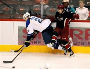 St. Louis Blues' Patrik Berglund (21) and Phoenix Coyotes' David Schlemko battle for the puck during the second period of an NHL hockey game, Friday, Dec. 23, 2011, in Glendale, Ariz. (AP Photo/Matt York) By Matt York