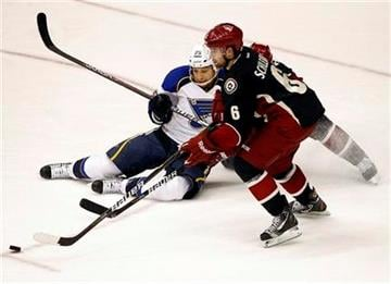 St. Louis Blues' Chris Stewart (25) battles Phoenix Coyotes' David Schlemko (6) for the puck during the second period of an NHL hockey game, Friday, Dec. 23, 2011, in Glendale, Ariz. (AP Photo/Matt York) By Matt York