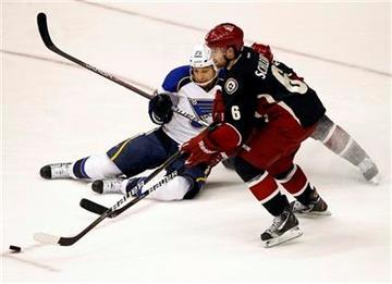 St. Louis Blues' Chris Stewart (25) battles Phoenix Coyotes' David Schlemko (6) for the puck during the second period of an NHL hockey game, Friday, Dec. 23, 2011, in Glendale, Ariz. (AP Photo/Matt York) By Matt York
