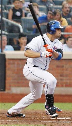 New York Mets' Carlos Beltran hits a double during the third inning of a baseball game against the St. Louis Cardinals Tuesday, July 19, 2011, at Citi Field in New York. (AP Photo/Frank Franklin II) By Frank Franklin II