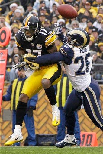 St. Louis Rams cornerback Roderick Hood (26) breaks up a pass to Pittsburgh Steelers wide receiver Mike Wallace (17) in the first quarter of the NFL football game on Saturday, Dec. 24, 2011, in Pittsburgh. (AP Photo/Gene J. Puskar) By Gene J. Puskar
