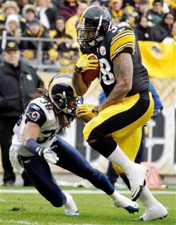 Pittsburgh Steelers running back John Clay gets past St. Louis Rams defensive back Chris Smith (36) for a touchdown in the second quarter of an NFL football game on Saturday, Dec. 24, 2011, in Pittsburgh. (AP Photo/Gene J. Puskar) By Gene J. Puskar
