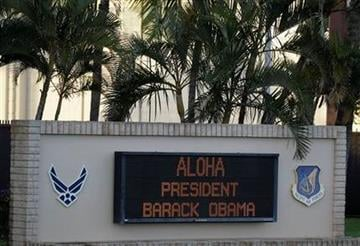 A sign at Hickam Air Force Base welcomes President Barack Obama for his holiday vacation in Honolulu, Friday, Dec. 23, 2011. (AP Photo/Eric Risberg) By Eric Risberg