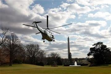 President Barack Obama leaves the White House for Christmas in Hawaii on board Marine One, in Washington, on Friday, Dec. 23, 2011. (AP Photo/Jacquelyn Martin) By Jacquelyn Martin