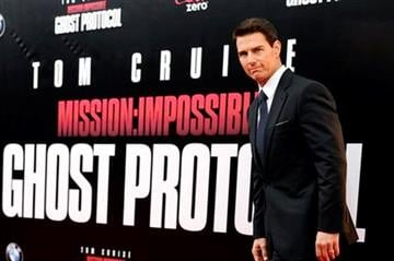 """Actor Tom Cruise attends the U.S. premiere of """"Mission: Impossible - Ghost Protocol"""" at the Ziegfeld Theatre on Monday, Dec. 19, 2011 in New York. (AP Photo/Evan Agostini) By Evan Agostini"""
