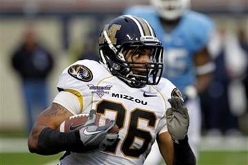 Missouri running back De'Vion Moore runs past a North Carolina defender for a 26-yard gain in the first quarter of their Independence Bowl college football game in Shreveport, La., Monday, Dec. 26, 2011. (AP Photo/Rogelio V. Solis) By Rogelio V. Solis