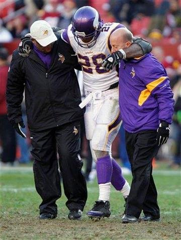 Minnesota Vikings running back Adrian Peterson (28) is helped off the field after an injury during the second half of an NFL football game against Washington Redskins in Landover, Md., Saturday, Dec. 24, 2011. (AP Photo/Evan Vucci) By Evan Vucci