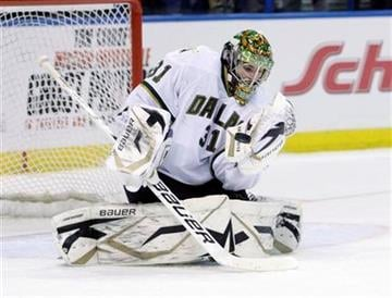 Dallas Stars goalie Richard Bachman (31) makes a glove save in the second period of an NHL hockey game against the St. Louis Blues, Monday, Dec. 26, 2011 in St. Louis.(AP Photo/Tom Gannam) By Tom Gannam
