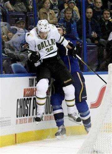 Dallas Stars' Philip Larsen (36) misses slamming St. Louis Blues' Alex Pietrangelo (27) into the boards in the first period of an NHL hockey game, Monday, Dec. 26, 2011 in St. Louis.(AP Photo/Tom Gannam) By Tom Gannam