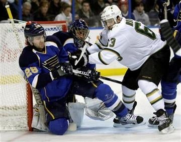 Dallas Stars' Mike Ribeiro (63) knocks down St. Louis Blues' Carlo Colaiacovo (28) in front of goalie Jaroslav Halak (41) in the first period of an NHL hockey game, Monday, Dec. 26, 2011 in St. Louis.(AP Photo/Tom Gannam) By Tom Gannam