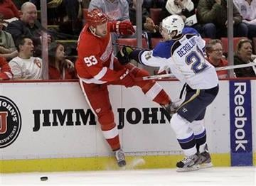 St. Louis Blues center Patrik Berglund (21) checks Detroit Red Wings right wing Johan Franzen (93) during the first period of an NHL hockey game in Detroit, Tuesday, Dec. 27, 2011. (AP Photo/Carlos Osorio) By Carlos Osorio
