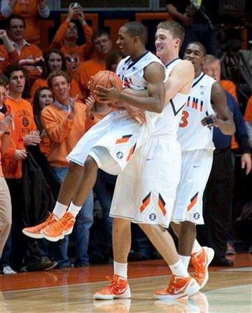 Illinois' Meyers Leonard picks up  Tracy Abrams after Illinois defeated Minnesota 81-72 in double overtime in an NCAA college basketball game in Champaign, Ill., Tuesday, Dec. 27, 2011. (AP Photo/Robert K. O'Daniell) By Robert K. O'Daniell