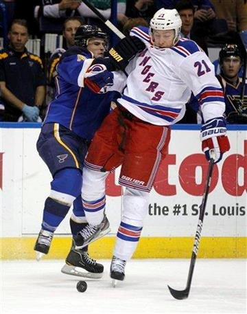 St. Louis Blues' Kris Russell, left, and New York Rangers' Derek Stepan collide while chasing a loose puck during the first period of an NHL hockey game Thursday, Dec. 15, 2011, in St. Louis. (AP Photo/Jeff Roberson) By Jeff Roberson