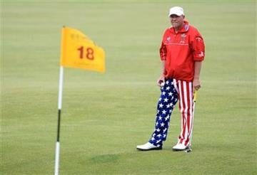 John Daly of the U.S. waits to putt on the 18th hole during his final round of the British Open Golf Championship on the Old Course at St. Andrews, Scotland, Sunday, July 18, 2010. (AP Photo/Tim Hales) By Tim Hales