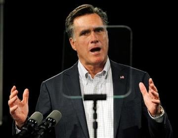 Republican presidential candidate, former Massachusetts Gov. Mitt Romney reads from a tele-prompter as he makes a campaign speech in Bedford, N.H. Tuesday, Dec. 20, 2011. (AP Photo/Elise Amendola) By Elise Amendola