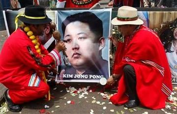 Shamans perform a ritual for good luck in 2012 as they hold up a poster of North Korea's next leader Kim Jong Un in Lima, Peru, Thursday Dec. 29, 2011. (AP Photo/Karel Navarro) By Karel Navarro