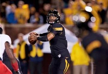Missouri quarterback James Franklin throws a pass during the fourth quarter of an NCAA college football game against Arkansas State Saturday, Sept. 28, 2013, in Columbia, Mo. Missouri won the game 41-19. (AP Photo/L.G. Patterson) By L.G. Patterson
