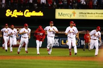 ST LOUIS, MO - OCTOBER 09:  The St. Louis Cardinals celebrate defeating the Pittsburgh Pirates 6 to 1 in Game Five of the National League Division Series at Busch Stadium on October 9, 2013 in St Louis, Missouri.  (Photo by Elsa/Getty Images) By Elsa