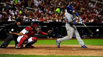 Yasiel Puig #66 of the Los Angeles Dodgers hits a single off of Joe Kelly #58 of the St. Louis Cardinals during the sixth inning at Busch Stadium on August 6, 2013 in St. Louis, Missouri.  (Photo by Jeff Curry/Getty Images) By Jeff Curry