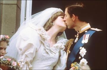 FILES- File picture dated 29 July 1981 showing Prince and Princess of Wales kissing during their wedding. Lady Diana died 31 August in a car crash in Paris.   (Photo credit should read /AFP/Getty Images) By AFP