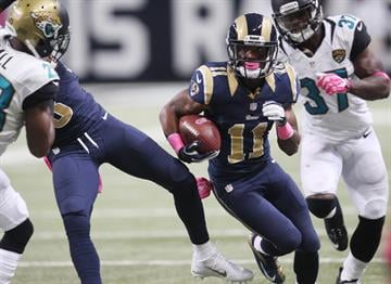 St. Louis Rams Tavon Austin runs through the Jacksonville Jaguars defense during a punt return in the first quarter at the Edward Jones Dome in St. Louis on October 6, 2013. St. Louis won the game 34-20.  UPI/Bill Greenblatt By BILL GREENBLATT