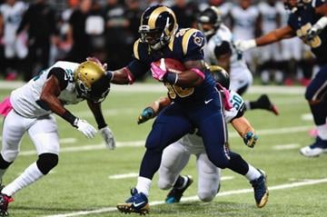 ST. LOUIS, MO - OCTOBER 6: Zac Stacy #30 of the St. Louis Rams rushes against the Jacksonville Jaguars at the Edward Jones Dome on October 6, 2013 in St. Louis, Missouri.  (Photo by Michael Thomas/Getty Images) By Michael Thomas