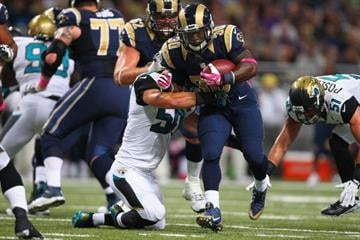 ST. LOUIS, MO - OCTOBER 6: Zac Stacy #30 of the St. Louis Rams breaks a tackle against the Jacksonville Jaguars at the Edward Jones Dome on October 6, 2013 in St. Louis, Missouri.  (Photo by Dilip Vishwanat/Getty Images) By Dilip Vishwanat