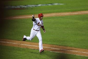 Runners on first and second and a 3-1 count to Carlos Beltran. Beltran knew he would get a good pitch to hit and he stroked it down the right field line allowing Descalso to score easily from second. By Ed Zurga