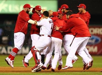 Carlos Beltran did it all in Game 1 of the NLCS with a pivotal outfield assist in the 10th inning and the walk-off RBI single in the 13th to give the Cards a 1-0 advantage over the Dodgers. By Elsa