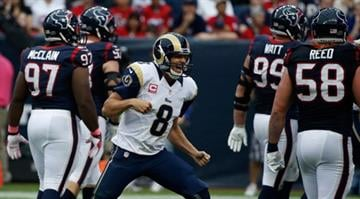 HOUSTON, TX - OCTOBER 13:  Sam Bradford #8 of the St. Louis Rams celebrates a third quarter touchdown pass against the Houston Texans at Reliant Stadium on October 13, 2013 in Houston, Texas.  (Photo by Scott Halleran/Getty Images) By Scott Halleran