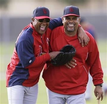 St. Louis Cardinals visiting coach Ozzie Smith, left, laughs with third base coach Jose Oquendo during spring training baseball, Tuesday, Feb. 19, 2013, in Jupiter, Fla. (AP Photo/Julio Cortez) By Julio Cortez