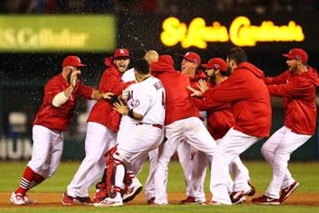 ST LOUIS, MO - OCTOBER 11:  The St. Louis Cardinals celebrate defeating the Los Angeles Dodgers in Game One of the National League Championship Series at Busch Stadium on October 11, 2013 in St Louis, Missouri.  (Photo by Elsa/Getty Images) By Elsa